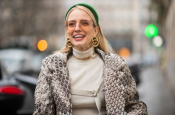 PARIS, FRANCE - JANUARY 23: Leonie Hanne is seen wearing green Prada head band, Dior necklace, earings, turtleneck, coat with snake print outside Jean Paul Gaultier during Paris Fashion Week - Haute Couture Spring Summer 2019 on January 23, 2019 in Paris, France. (Photo by Christian Vierig/Getty Images)